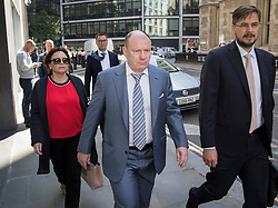 © Licensed to London News Pictures. 15/05/2018. London, UK. Russian billionaire Vladimir Potanin (C) arrives at the Rolls Building of the High Court. Billionaire Oleg Deripaska is challenging the sale of shares in Nornickel by Chelsea football club owner Roman Abramovich to Mr Potanin.  Photo credit: Peter Macdiarmid/LNP