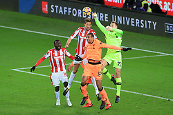 29th November 2017 - Premier League - Stoke City v Liverpool - Liverpool goalkeeper Simon Mignolet punches clear from teammate Joel Matip as well as Stoke players Peter Crouch (C) and Mame Biram Diouf (L) - Photo: Simon Stacpoole / Offside.