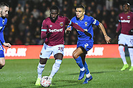 West Ham United defender Arthur Masuaku (26) and Wimbledon defender Tennai Watson (2) battle for the ball during the The FA Cup fourth round match between AFC Wimbledon and West Ham United at the Cherry Red Records Stadium, Kingston, England on 26 January 2019.