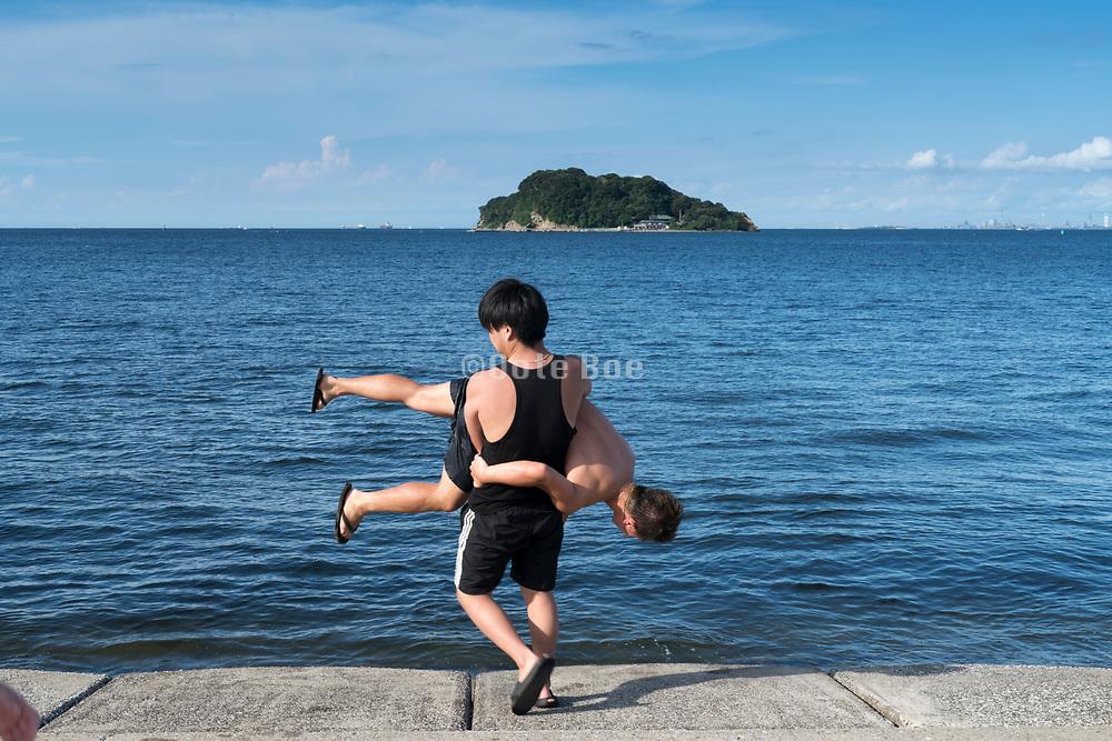 young adult having fun Tokyo Bay with Sarushima Island Yokosuka