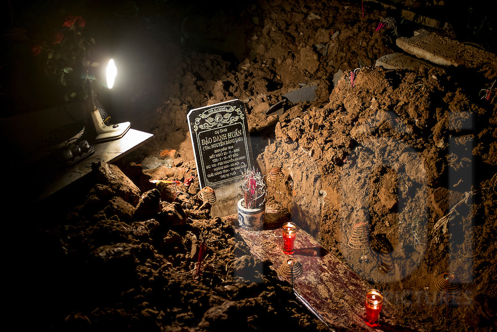 The ancestor's coffin is dug up for the reburial ritual in a suburb of Hanoi, Vietnam, Southeast Asia