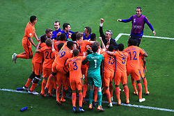 Netherlands U17's players celebrate winning the penalty shoot out
