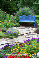 63821-21806 Blue bench and stone path in flower garden.  Homestead Purple Verbena (Verbena canadensis), Red Verbena, New Gold Lantana (Lantana camara) Butterfly Bushes, Zinnias, Sedums, Marion Co., IL