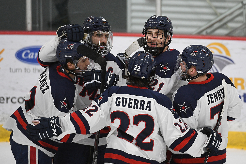 PITTSBURGH, PA - MARCH 13: Justin Addamo #21 of the Robert Morris Colonials celebrates with teammates after scoring a goal in the first period during Game Two of the Atlantic Hockey Quarterfinal series against the Niagara Purple Eagles at Clearview Arena on March 13, 2021 in Pittsburgh, Pennsylvania. (Photo by Justin Berl/Robert Morris Athletics)