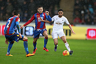 Neil Taylor of Swansea city ® goes past Yohan Cabaye of Crystal Palace. Barclays Premier league match, Swansea city v Crystal Palace at the Liberty Stadium in Swansea, South Wales on Saturday 6th February 2016.<br /> pic by Andrew Orchard, Andrew Orchard sports photography.