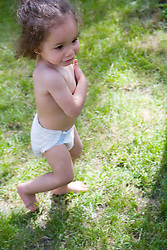 Little girl playing in the garden,