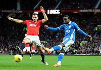 20111226: LONDON, UK - Barclays Premier League 2011/2012:  <br /> Manchester United vs Wigan Athletic.<br /> In photo: Victor Moses of Wigan Athletic shoots as Darron Gibson of Manchester United.<br /> PHOTO: CITYFILES