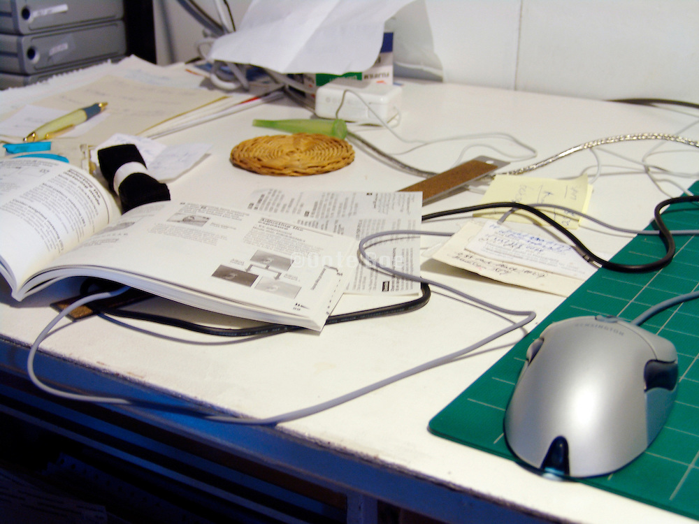 A close up of a messy desk.