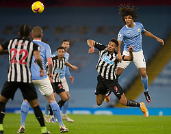 Nathan Ake of Manchester City (R) heads clear - Mandatory by-line: Jack Phillips/JMP - 26/12/2020 - FOOTBALL - Etihad Stadium - Manchester, England - Manchester City v Newcastle United - English Premier League
