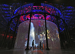 © licensed to London News Pictures. LONDON, UK.  08/08/11. People inexact with Sorid Earth by Matt Collishaw. Ron Arad's Curtain Call opens at the Roundhouse, Camden in London today (9th August 2011). Arad has installed a huge light curtain made of 5,600 silicon rods, suspended from an 18 metre diameter ring. Films, live performance and audience interaction can all take place within and around the rods. Mandatory Credit Stephen Simpson/LNP