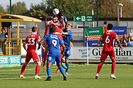 AFC Wimbledon defender Deji Oshilaja (4) battles to win header in box during the EFL Sky Bet League 1 match between AFC Wimbledon and Scunthorpe United at the Cherry Red Records Stadium, Kingston, England on 15 September 2018.
