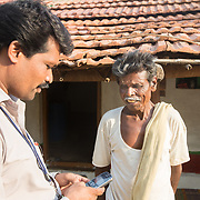 CAPTION: Gathering community data. Mobility India and CBM have partnered with Aptivate to develop a simple means of collecting key project-relevant data using relatively unsophisticated mobile phones. LOCATION: Sappayyanapura (village), Kasaba (hobli), Chamrajnagar (district), Karnataka (state), India. INDIVIDUAL(S) PHOTOGRAPHED: Left: P. Murthy; right: Siddaya.