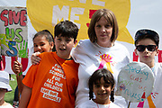 Labour MP Jess Phillips and son Danny join school children  during a protest in Parliament Square in London, United Kingdom on 5th July, 2019. Campaign group Save Our Schools say schools are being forced to close early on Fridays from September because of funding cuts.