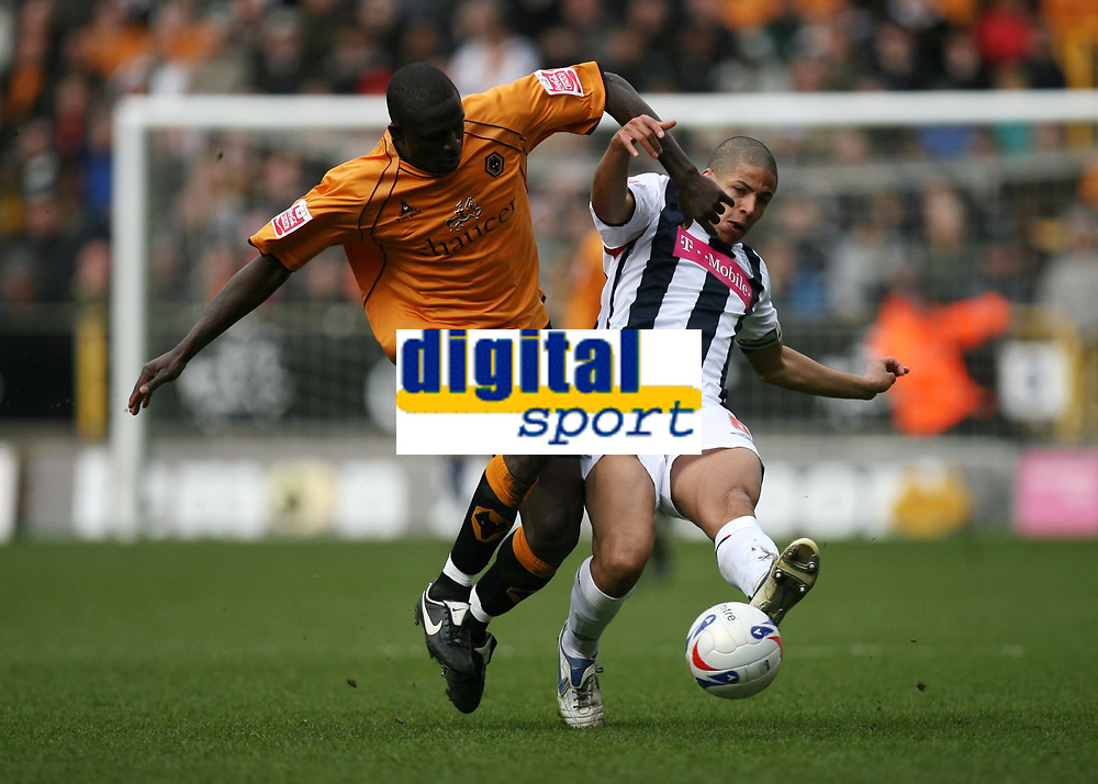 Photo: Rich Eaton.<br /> <br /> Wolverhampton Wanderers v West Bromwich Albion. Coca Cola Championship. 11/03/2007. Seyi Olofinjana left of Wolves tackles West Brom captain Curtis Davies