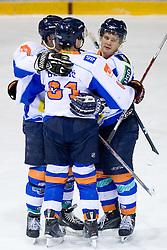 Dejan Zemva (R) and Players of Triglav celebrate at SLOHOKEJ league ice hockey match between HK Slavija and HK Triglav Kranj, on February 3, 2010 in Arena Zalog, Ljubljana, Slovenia. Triglaw won 4:1. (Photo by Vid Ponikvar / Sportida)