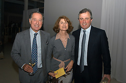 Left to right, JOHN & JILL RITBLAT and VISCOUNT ASTOR at an exhibition of work by Rolf Sachs - a unique world-renowned contemporary furniture designer, held in association with the Louisa Guinness Gallery and held at 250 Brompron Road, London on 6th October 2004.<br />