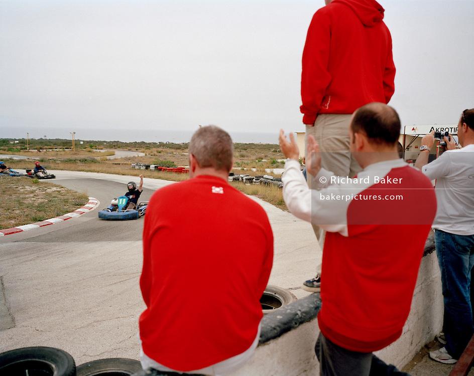 Members of the Red Arrows, Britain's RAF aerobatic team enjoy go-karting on MoD land at RAF Akrotiri.