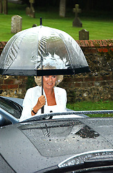 The DUCHESS OF CORNWALL at the wedding of Tom Parker Bowles to Sara Buys at St.Nicholas Church, Rotherfield Greys, Oxfordshire on 10th September 2005.<br />