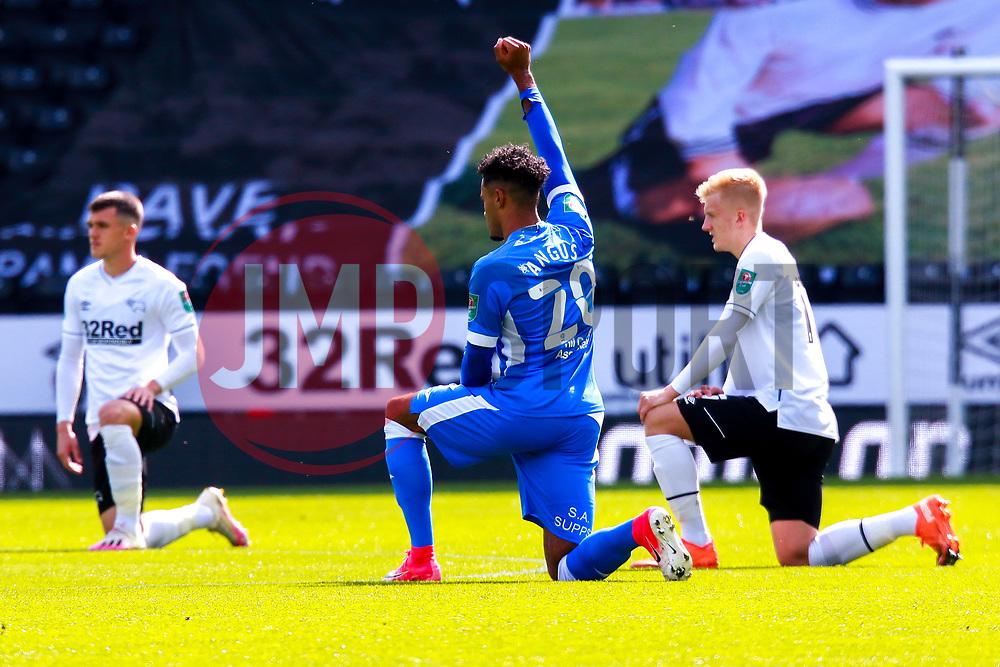 Dior Angus of Barrow raises a fist while taking the knee before kick off - Mandatory by-line: Ryan Crockett/JMP - 05/09/2020 - FOOTBALL - Pride Park Stadium - Derby, England - Derby County v Barrow - Carabao Cup