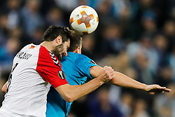 November 23, 2017 - Saint Petersburg, Russia - Artem Dzyuba (R) of FC Zenit Saint Petersburg and Boban Grncharov of FK Vardar vie for a header during the UEFA Europa League Group L match between FC Zenit St. Petersburg and FK Vardar at Saint Petersburg Stadium on November 23, 2017 in Saint Petersburg, Russia. (Credit Image: © Mike Kireev/NurPhoto via ZUMA Press)