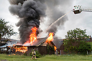 Firefighters work to put out a blaze in an abandonded building at the former Middletown Psychiatric Center in Middletown, New York.