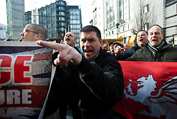 © London News Pictures. 26/02/2014. London, UK.  Supporteres of the BNP and other demonstrators vent their anger outside  the Old Bailey in London where Michael Adebolajo and Michael Adebowale are due to be sentenced for the murder of Fusilier Lee Rigby who was attacked near Woolwich Barracks in south-east London on May 22, 2013. Photo credit: Ben Cawthra/LNP