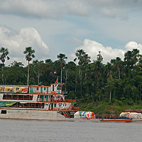 A heavily-laden ship carries passengers and cargo on the Amazon River near Iquitos, Peru.
