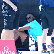 Usain Bolt, Jamaica, sits in the shade before the Men's 200m during the Diamond League Adidas Grand Prix at Icahn Stadium, Randall's Island, Manhattan, New York, USA. 13th June 2015. Photo Tim Clayton