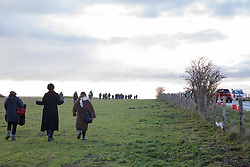 Salisbury, UK. 5th December, 2020. Over one hundred people, including local residents, climate and land justice activists and pagans, walk along the route of the Stonehenge tunnel during a Mass Trespass at Stonehenge. The trespass was organised in protest against the approval by Transport Secretary Grant Shapps of a £1.7bn project for a two-mile tunnel beneath the World Heritage Site and a further eight miles of dual carriageway for the A303, as well as the government's £27bn Road Investment Strategy 2 (RIS2).