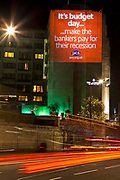 The Intercontinental Hotel, Park Lane. PCS Union projected some of London main building with anti cut slogans and encouraged people to attend the March.