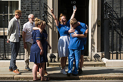 Matthew Tovey and other NHS workers from the grassroots NHSPay15 campaign, supported by former Labour Party leader Jeremy Corbyn and Labour MP Lloyd Russell-Moyle, celebrate outside 10 Downing Street after presenting a petition signed by over 800,000 people calling for a 15% pay rise for NHS workers on 20th July 2021 in London, United Kingdom. At the time of presentation of the petition, the government was believed to be preparing to offer NHS workers a 3% pay rise in 'recognition of the unique impact of the pandemic on the NHS'.