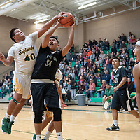 In Newcomb, Tracy Bryant (40) of Newcomb gets the block on Douglas Whitehorse (34) of Tse Yi Gai in paint. Newcomb won 83-49 on Saturday.