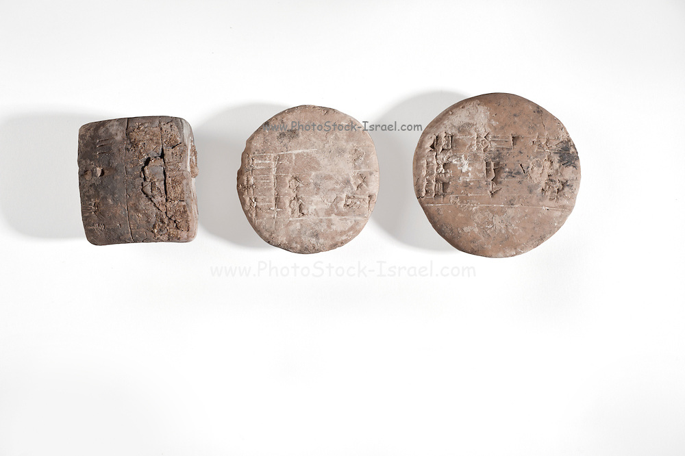 3 pictographic clay tablets with administrative text Uruk Period circa 3000 BCE