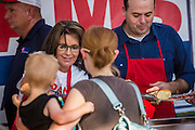 27 AUGUST 2012 - GILBERT, AZ: SARAH PALIN and KIRK ADAMS serve barbecue at a campaign barbecue for Adams, a candidate for US Congress, Monday. Sarah Palin campaigned for Arizona Republicans aligned with the Tea Party movement at a barbecue in Gilbert, AZ, a suburb of Phoenix. She campaigned for Kirk Adams, who is running for Congress and Jeff Flake, who is running for US Senate. Palin spoke and served barbecued chicken in 108 degree heat.       PHOTO BY JACK KURTZ