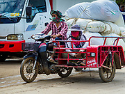05 JULY 2017 - POIPET, CAMBODIA:  Used clothes sellers in Poipet, Cambodia, take their merchandise to Thailand. Poipet is the busiest border crossing between Thailand and Cambodia and where most of the Cambodian migrant workers going to Thailand start their journeys. The Thai government proposed new rules for foreign workers recently. The new rules include fines of between 400,000 and 800,00 Thai Baht ($12,000 - $24,000 US) and jail sentences of up to five years for illegal workers and people who hire illegal workers. Hundreds of companies fired their Cambodian and Burmese workers and tens of thousands of workers left Thailand to return to their countries of origin. Employers and human rights activists complained about the severity of the punishment and sudden implementation of the rules. On Tuesday, 4 July, the Thai government suspended the new rules for 180 days and the Cambodian and Myanmar governments urged their citizens to stay in Thailand, but the exodus of workers continued through Wednesday.    PHOTO BY JACK KURTZ