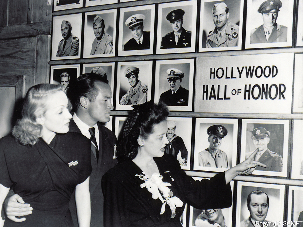 10/31/43 Betty Davis points to the Canteen's Hall of Honor while Bob Hope and Marlene Dietrich look on.