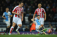 Stoke City's Charlie Adam is tackled by Blackburn Rovers' Corry Evans<br /> <br /> Photographer Kevin Barnes/CameraSport<br /> <br /> Football - The FA Cup Fifth Round - Blackburn Rovers v Stoke City - Saturday 14th February 2015 -  Ewood Park - Blackburn<br /> <br /> © CameraSport - 43 Linden Ave. Countesthorpe. Leicester. England. LE8 5PG - Tel: +44 (0) 116 277 4147 - admin@camerasport.com - www.camerasport.com