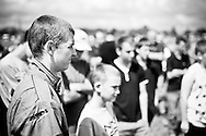 Matt Covey listens attentively to the drivers' brieging before the race meeting at Smallfield Raceway, Surrey, UK on the 10th of July 2011 (photo by Andrew Tobin/SLIK images)