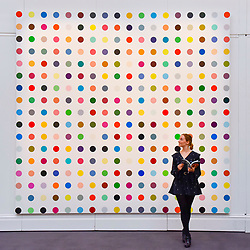 """© Licensed to London News Pictures. 23/06/2017. London, UK. A staff member views """"1-Heptene"""", 2004-2011, by Damien Hirst (estimate GBP0.5-0.7m) at the preview of Sotheby's Contemporary Art Sale in New Bond Street.  The auction, which is dominated by Pop art, takes place on 28 June. Photo credit : Stephen Chung/LNP"""