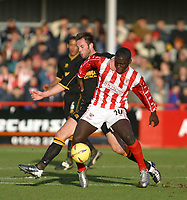 Photo: Jo Caird<br /> Cheltenham v Hull city<br /> Whaddon Rd<br /> Nationwide Div 3 2004<br /> 23/01/2004.<br /> <br /> Damian Spencer fends off Ian Ashbee