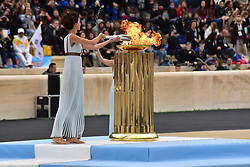 October 31, 2017 - Athens, Attiki, Greece - High Priestess Katerina Lehou is lighting a Torch that is going to handover at the end to the President of the Organising Committee for the XXIII Winter Olympics Games 'PYEONGCHANG 2018' Lee Hee Beom. The Handover Ceremony of the Olympic Flame for Winter Games PYEONGCHANG 2018, took place today in Panathenaic Stadium in the presence of the President of Hellenic Republic Prokopis Pavlopoulos. (Credit Image: © Dimitrios Karvountzis/Pacific Press via ZUMA Wire)