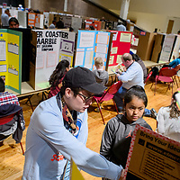 Tuba City Primary School fifth-grader Santiena Kuwanhyeina, right, explains her science project about her acrophobic cat to judge Andy Nez during the Navajo Nation Science Fair Wednesday at Red Rock Park in Gallup.