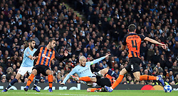 Shakhtar Donetsk's Taras Stepanenko (second right) brings down David Silva in the box, resulting in a penalty during the UEFA Champions League match at the Etihad Stadium, Manchester.