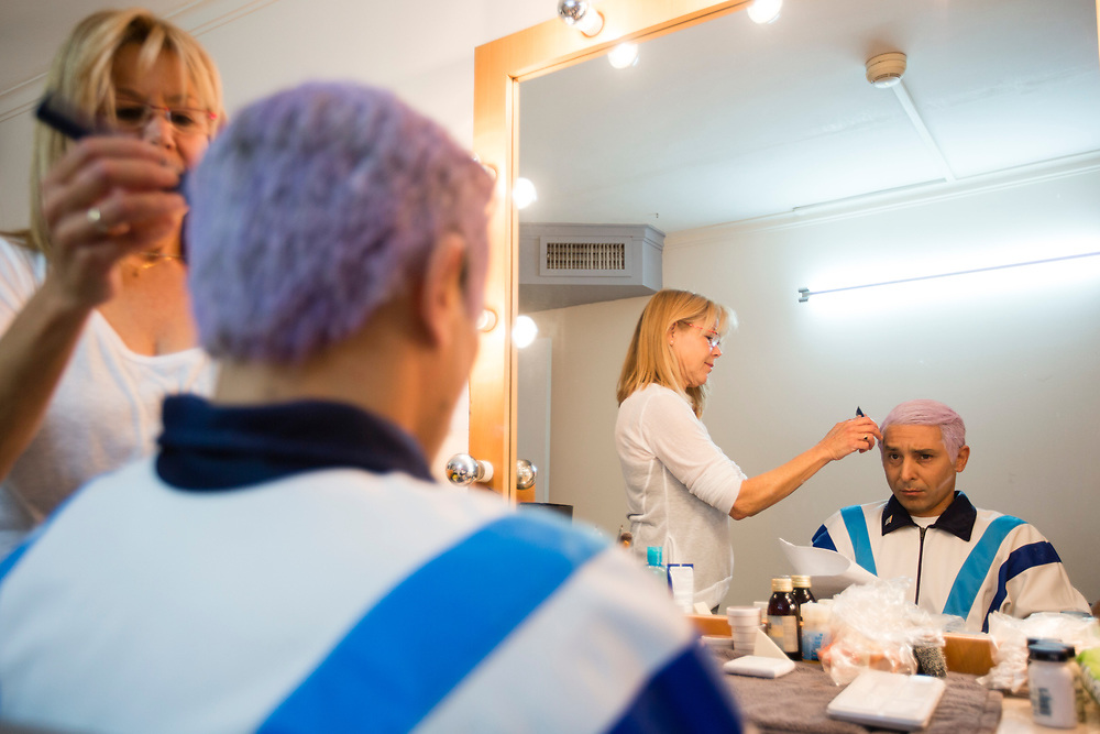 Israeli comic actor Mariano Idelman, who plays the role of Israeli Prime Minister Benjamin Netanyahu, sits as he gets his makeup done backstage, prior to a filming of an episode of the top-rated Israeli satirical show 'Eretz Nehederet', Hebrew for 'Wonderful Country' at a television studio in Herzliya, Israel, on January 26, 2015.