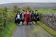"""18/04/2017 REPRO FREE:  <br /> Post BAC Graduates  Charlotte Lavelle and  Morgan Whitehead, PHD Elizabeth Matthews, MFA Graduates Sherry Erskine and Joan Nanfuka and MA graduate Angel Cray  who graduated from at the 13th conferring ceremony, held in the Minstrels gallery the 16th century Newtown Castle at the heart of the BCA campus, exemplifies the continued success of the Burren's  alternative model of art education . The Irish and  international graduates included Elizabeth Matthews, conferred with  a PhD for her research on Utopian studies , and six international graduates whose work on display in the BCA gallery addressed the ultimate question, """"who am I called to be"""" In her address President of the college Mary Hawkes Greene referred to the unique place based educational  model  committed to  individual student centred  education accredited by NUIGalway , and how it effectively  embraces the often conflicting forces of the global and the local, the public and the private as well as the collective and the individual. <br /> .  Photo:Andrew Downes, xposure"""
