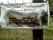 """Cherry orchard banner sign """"The Grimm Development - Reap the Benefits!  Call Now to Reserve Your Condo"""""""