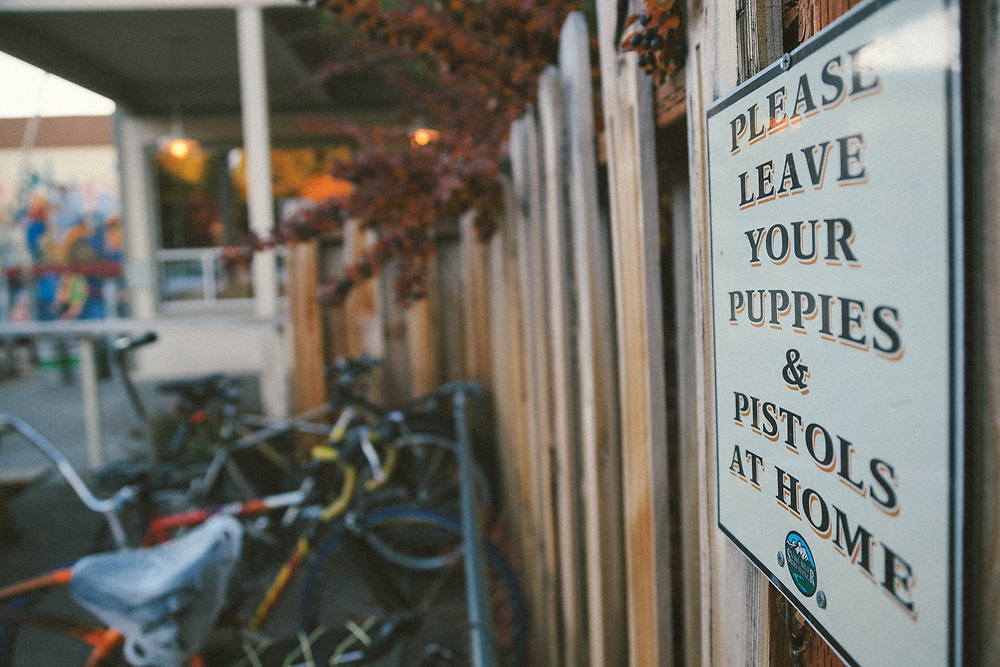 The stickers, bikes, and signs in the parking lot of Snake River Brewing in downtown Jackson, Wyoming.