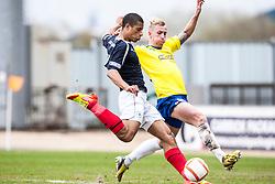 Falkirk's Lyle Taylor and Morton's Craig Reid..Falkirk 4 v 1 Morton, 4/5/2013..© Michael Schofield..