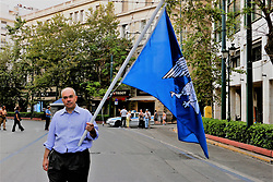 June 16, 2018 - Athens, Greece - A protester seen holding a flag during the protest.  .Big Demonstration in Syntagma as Greeks demand from the parliament to not vote yes at an agreement about the Macedonia Naming Dispute. (Credit Image: © Eleni Paroglou/SOPA Images via ZUMA Wire)