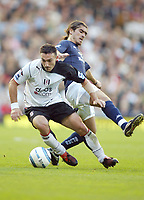 30/10/2004<br />FA Barclays Premiership - Fulham v Tottenham Hotspur - Craven Cottage, London<br />Fulham's Steed Malbranque and Tottenham Hotspur's Pedro Mendes<br />Photo:Jed Leicester/Back Page Images